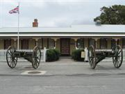 Garrison Barracks front south elevation and field guns