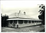 Front corner elevation of early building with an enclosed verandah