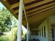 Homestead eaning verandah beam
