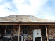 Southern facade - roof sheets replaced