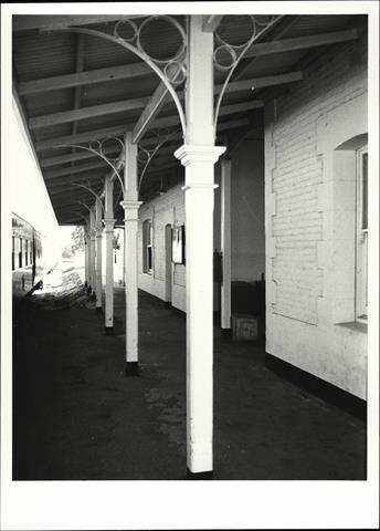 View along platform showing deatil of verandah posts and ironwork