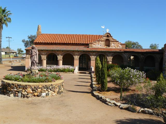 Priesthouse - north elevation across courtyard garden