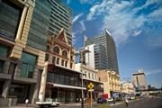 Street view of Wellington Street showing Bairds and Globe
